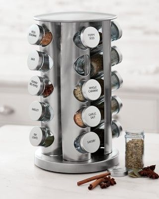 $49.95 - Williams Sonoma Brushed Stainless-Steel Spice Rack - This revolving rack blends seamlessly with the sleek polished surfaces of the contemporary kitchen. Made of stainless steel with a brushed finish, it holds 20 spice jars in a space-saving vertical arrangement. Spices are not included. Compact vertical rack revolves smoothly. Twenty glass jars have tin lids that provide a tight seal. Plastic sifter inserts let you sprinkle spices, and remove for filling or scooping. Includes 24…