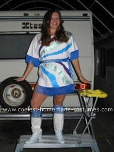 Homemade ABBA Costume: This ABBA costume was so easy to make. I bought 2 oversize white t-shirts, a few bottles of puff paint, blue fringe, 1/2 yard blue fabric, and 4 roles