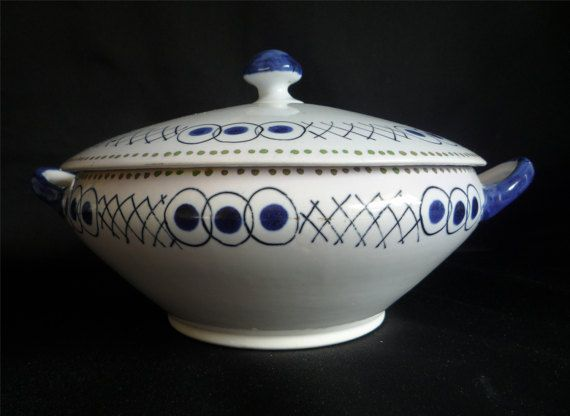 An extremely rare tureen designed by Vanessa Bell for the 1934 Harrods and Art in Industry exhibitions.The tureen is in very good condition aside from 2 tiny chips which are not seen on display. One is under the lid and the other on the top rim edge. It measures 10 inches ( 16.5 cm) from handle to handle. It is believed that only 12 sets of each design were produced.