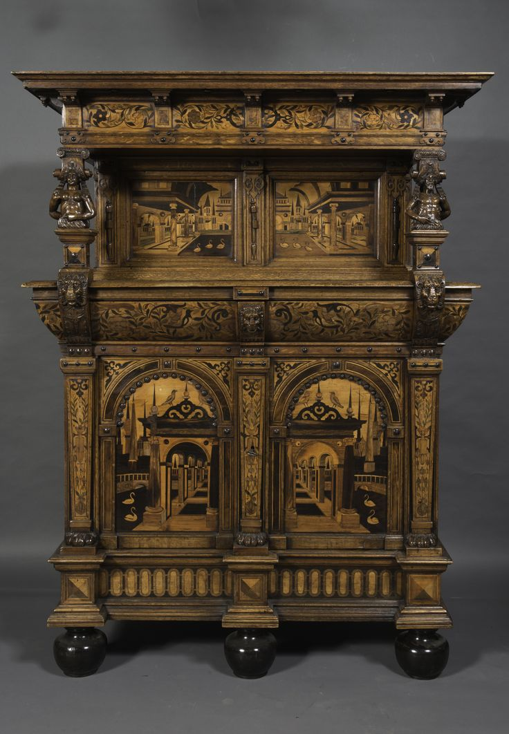 """Zeeuwse kast"" Zeeland, 1610-1620 Oak, walnut, and several exotic types of wood. 193 x 146 x 62  The design of the panels of this extraordinary cabinet are based on the drawings by Hans Vredeman de Vries from the 16th century."