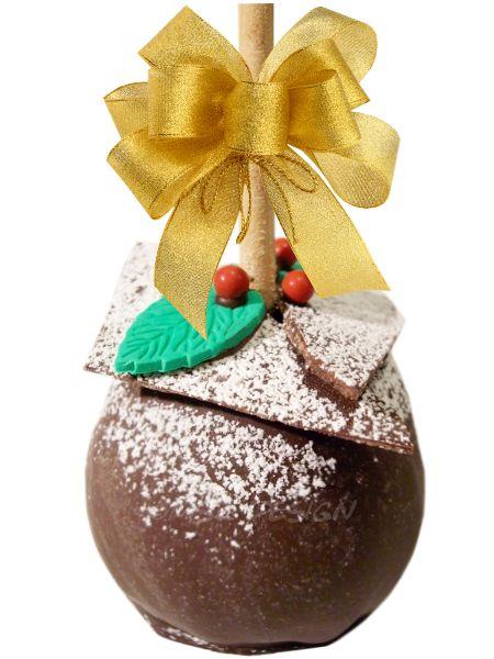 Manzana envuelta de caramelo con capa de chocolate semiamargo, decorada con laminas de chocolate, hojas de fondant, brillantina comestible, perlas de azúcar y azúcar glass.