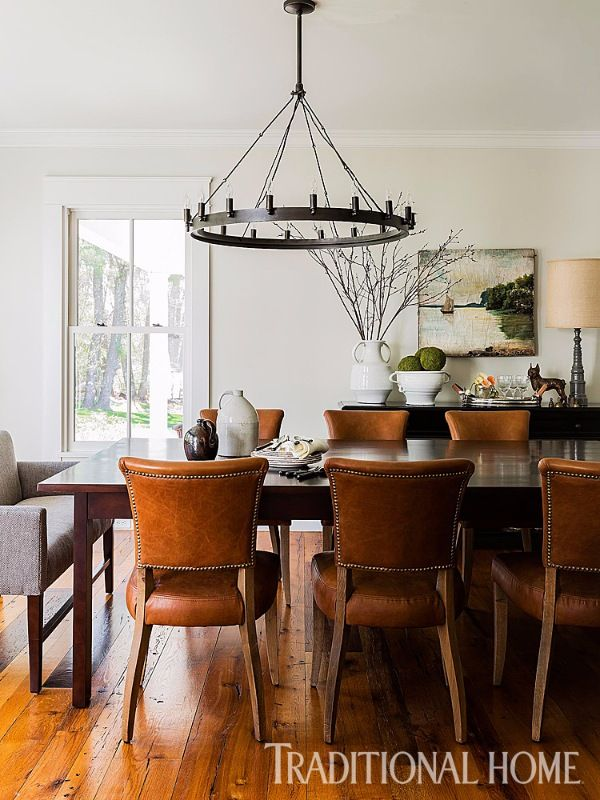"A custom ""Fermette"" table from Verellen—surrounded by leather ""Adèle"" chairs from RH—anchors this farmhouse dining room. - Photo: Michael Lee / Design: Jill Goldberg"