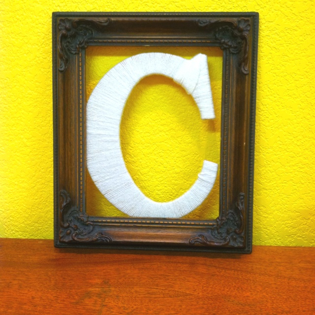 Frame with letter covered in yarn