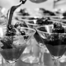 Rich chocolate mousse with Chantilly Cream and Autumn Berries, chocolate shard and homemade shortbread served in Martini glasses