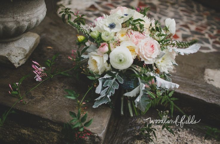 bridal bouquet of kiera garden roses, light pink ranunculus, white ranunculus, white veronica, white anemone, patience garden roses, cafe au lait dahlia, jasmine trails, dusty miller, fern & greenery wrapped in green gingham check ribbon