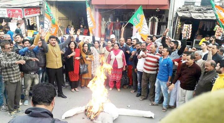 BJP activists protesting against statement of NC chief Dr Farooq Abdullah at Udhampur .