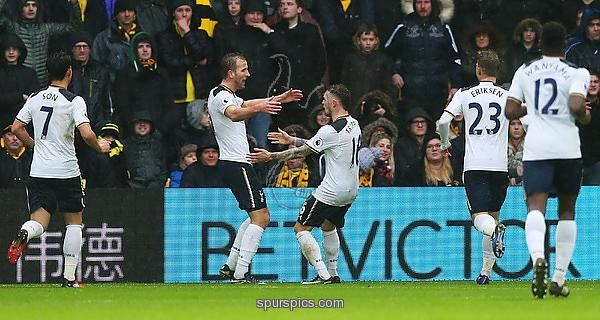 WATFORD, ENGLAND - JANUARY 01: Harry Kane of Tottenham Hotspur (2L) celebrates with Kieran Trippier (C) as he scores their first goal during the Premier League match between Watford and Tottenham Hotspur at Vicarage Road on January 1, 2017 in Watford, England