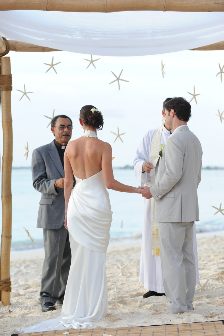 starfish bamboo arch by Celebrations Ltd wedding ceremony on seven mile beach, cayman islands