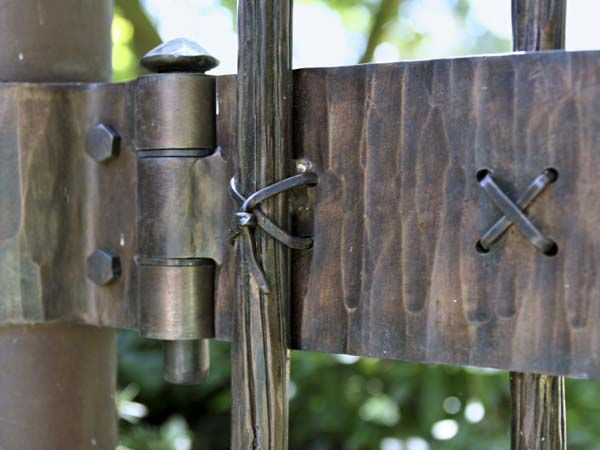 Delicate Hand-Hewn Details on the hinges made by american craftsperson and Blacksmith Maria Cristalli
