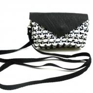 Price $37.99 - Handmade from soda pop tops collected at school sites throughout Mexico, this stylish bag is perfect for a cell phone or those bare essentials for the evening out. It has an 48 inch shoulder strap. It is approximately 5.5 inches by 3.5 inches, lined with a black fabric. The flap is made from inner t...