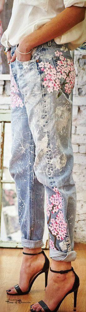 Denim adorned with painted pink flowers.
