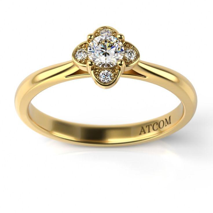 Cu un design delicat si expresiv, noul inel de logodna din aur galben 14k model Suave, incanta privirile prin stralucirile diamantelor montate cu migala si rafinament.