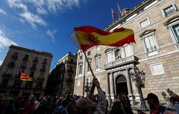 Work resumes normally in Catalonia as Spain enforces direct rule
