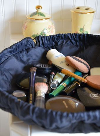 Lay-n-Go cosmetic bag- no more digging through your make up bag!< there's got to be a DIY for something like this.