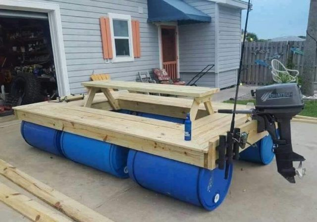 A Boat Made Of Wood And 55 Gallon Poly Drums