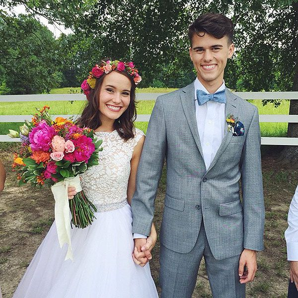 The Bride Wore a Flower Crown! See Duck Dynasty Stars' Sweet Wedding Photo http://www.people.com/article/ducky-dynasty-mary-kate-john-luke-robertson-wedding-photo