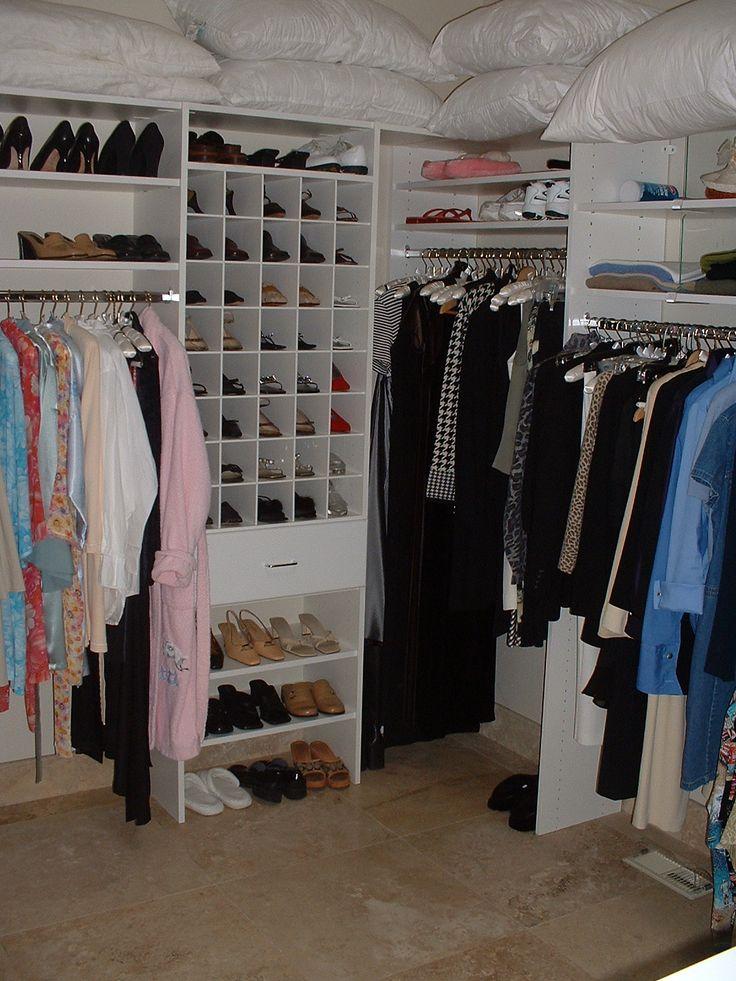 minimalist white color scheme walk in closet wardrobe design with l shaped modern white shelving design