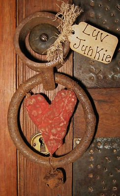 Old Rusty Iron Ring...with a grungy prim heart & jingle bell.