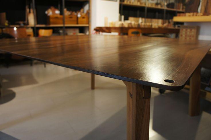 Square walnut table, corner detail