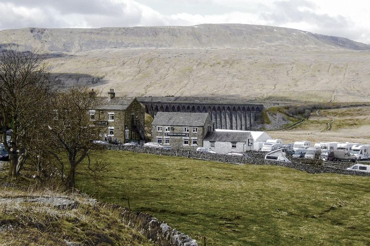 Taken in April 2015 the picture looks across the Batty Moss (Ribblehead) Valley towards The Station Inn, the famous Viaduct and what I believe to be Whernside Peak, all in North Yorkshire England. More of my pictures and information can be seen at, www.colingreenphotography.blogspot.co.uk