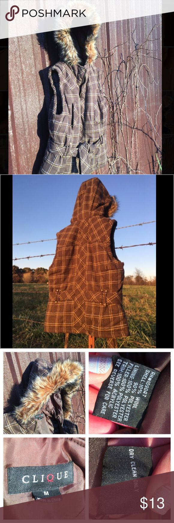 Clique Padded Plaid Fur Hooded Vest with Tie Clique Women's Padded Plaid Belted Vest With Faux Fur Trim Hood. Medium, zip up front. Two high zip horizontal pockets. Brown with yellow and white plaid. Excellent condition, worn once. Sizing runs small. Clinique Jackets & Coats Vests