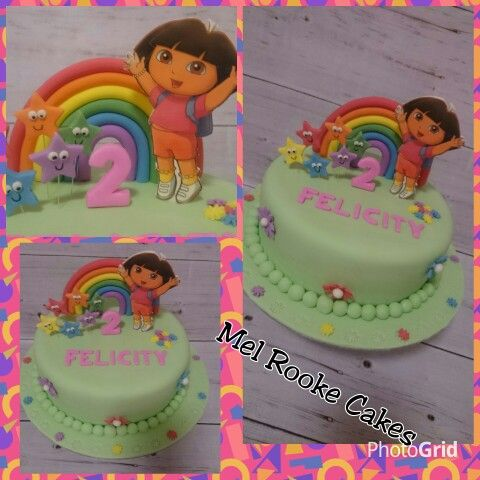 Dora the Explorer birthday cake with rainbow and stars