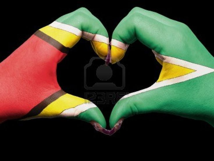 Gesture made by guyana flag colored hands showing symbol of heart and love Stock Photo - 13038812