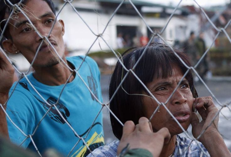 Nov. 2013: Survivors of Typhoon Haiyan wait for assistance, the Philippines - Found via Buzzfeed