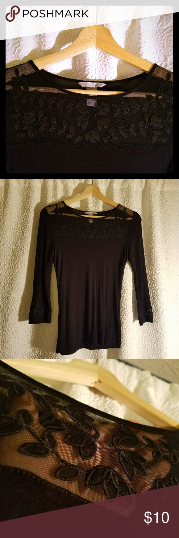 Black lace mesh embroidered 3/4 sleeve Pre-owned, great condition. Only worn 3 times! Unique sheer mesh embroidered collar, and same detail on the edge of both sleeves. Fitted, very soft and comfy. True black. H&M Tops Blouses