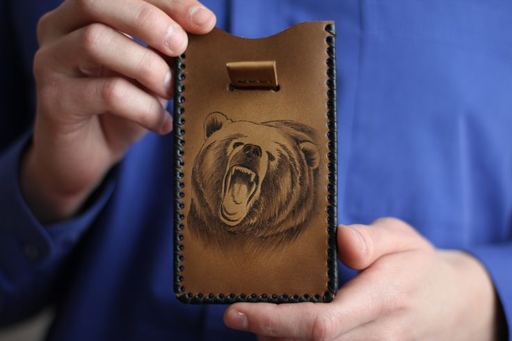 "iPhone case ""The Bear"". The material of product is the natural leather. There is burned image of the bear on the front part. We will can make specially case for your cellphone with your image. 18.69$ (isn't including shipping) #leathercase #tablet #iphone #handmade #russianhandmade #russian #russian_handmade #naturalleather #leather #cover #bear #case"