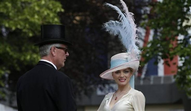 Lana Holloway poses for a photograph on the first day of Royal Ascot horse racing meet at Ascot, England, Tuesday, June 16, 2015. Royal Ascot is the annual five day horse race meeting that Britain's Queen Elizabeth II attends every day of the event. (AP Photo/Alastair Grant)