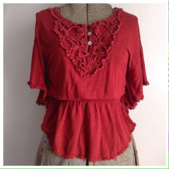 """Burnt red batwing top A 70's inspired batwing top with crochet and pompom detail. Faux abalone buttons with elastic waist. Length: 23"""" Waist: 22-36"""" #red #marsala #batwing #crochet #pompom #abalone #top Mossimo Supply Co Tops"""