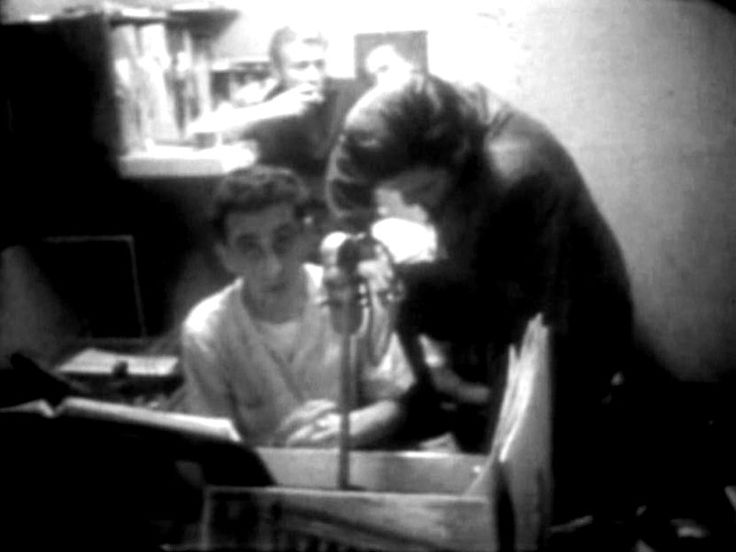 december 7 1956 visits George at the radio station.behind Elvis and George is  Nick Adams , Nick was in Memphis for the 1956 holidays