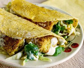 Vegan Tofu Fish Tacos. Battered pan fried tofu in corn tortillas with cole slaw & tartar sauce.