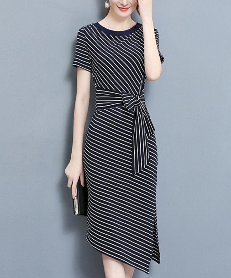 Take a look at this Black & White Stripe Asymmetrical Hem Midi Dress today!