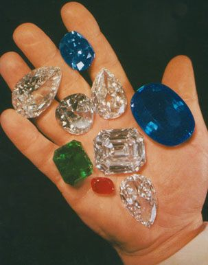 Hand that held history - Harry Winston. The 125.35 carat emerald cut Jonker diamond is at the center. Top left is the 94.80 carat pear shaped Star of the East diamond. The 45.52 carat blue Hope diamond rests between his index and middle finger. The 337.10 carat Sapphire of Catherine the Great is next to his thumb, and the 70.21 carat Idol's Eye diamond is just above the Jonker. 46.39 and 44.14 carats Indore Pears, matched pair of pear shaped diamonds and a larger ruby are also shown.