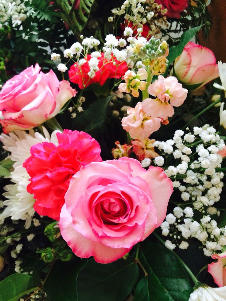 Pink roses, fuchsia carnations,  pink stock, pink spray roses and baby's breath