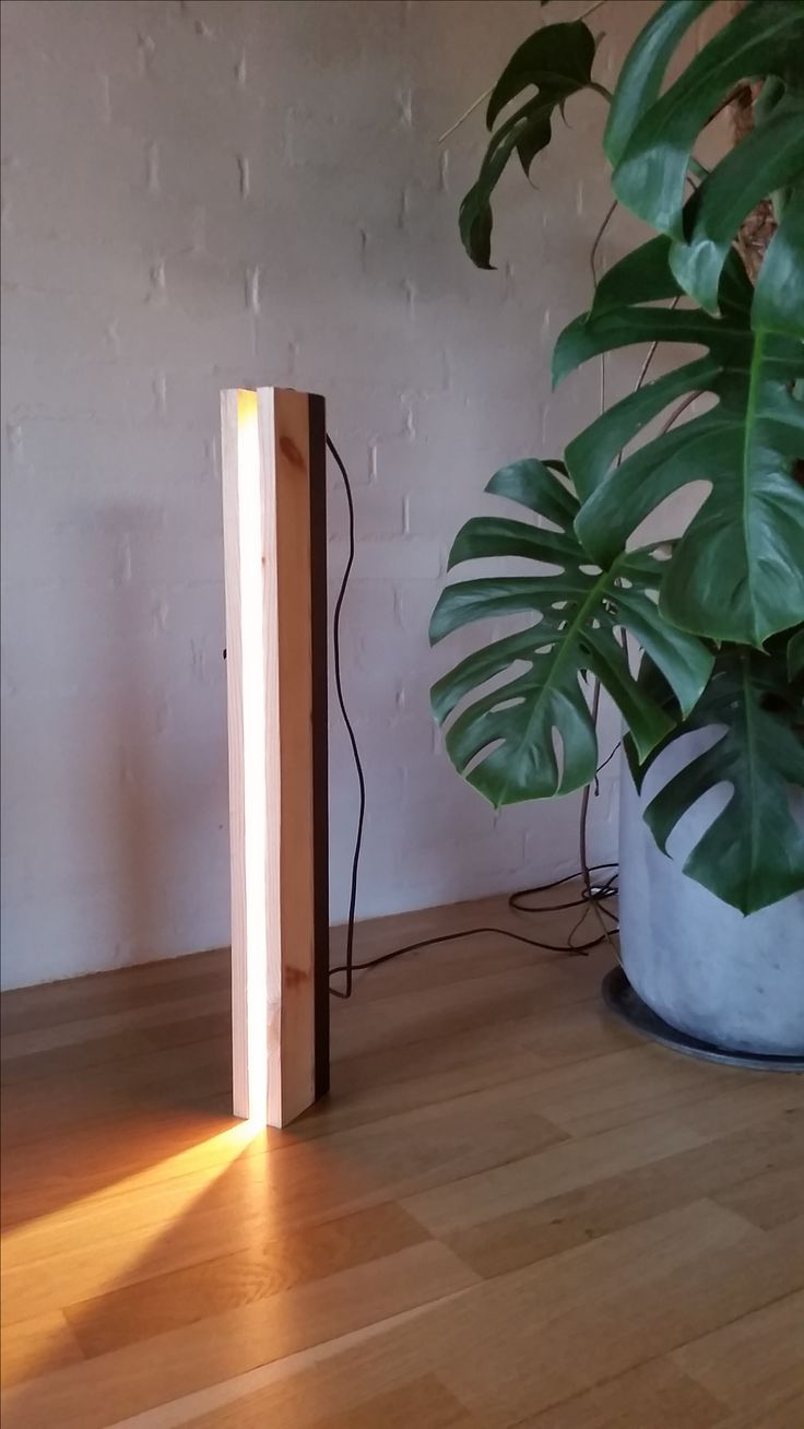 This lamp was inspired by how light beams are reflected by various surfaces.  Using wood to focus a beam of light, this project was an attempt at creating dramatic ambient light.  The lamp was made with a bit of left-over lightstrip and wood-scraps from other projects. Copyright Kenneth Theilgaard Christiansen