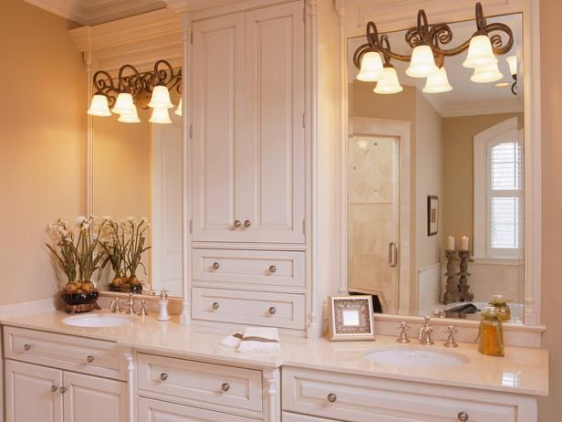 Middle Cabinet For Storage Between Large Mirrors And Separate Sinks Traditional Bathroom Featuring White Double