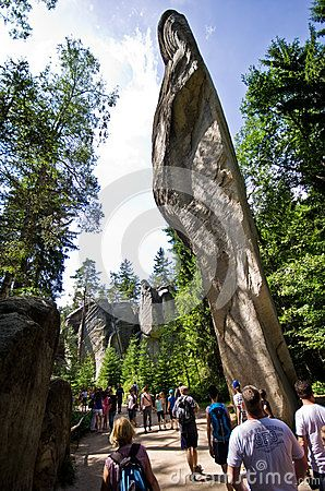 Tourists admiring the rock formations of Adrspach-Teplice Rock Town, Czech…