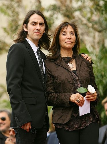 """April, 2009.   Dhani and Olivia Harrison at the posthumous ceremony honoring George Harrison with a star on the Hollywood Walk of Fame.  George Harrison in the Words of Friends and Family Olivia Harrison, Dhani Harrison, Tom Petty and Harrison himself reflect on the quiet Beatle.    """"The only things I felt I had to do in my life are to be happy and meditate."""" -Dhani Harrison.     George Harrison in the Words of Friends and Family Pictures 