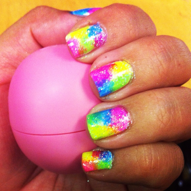 EOS lip balm and neon sponged glitter nails