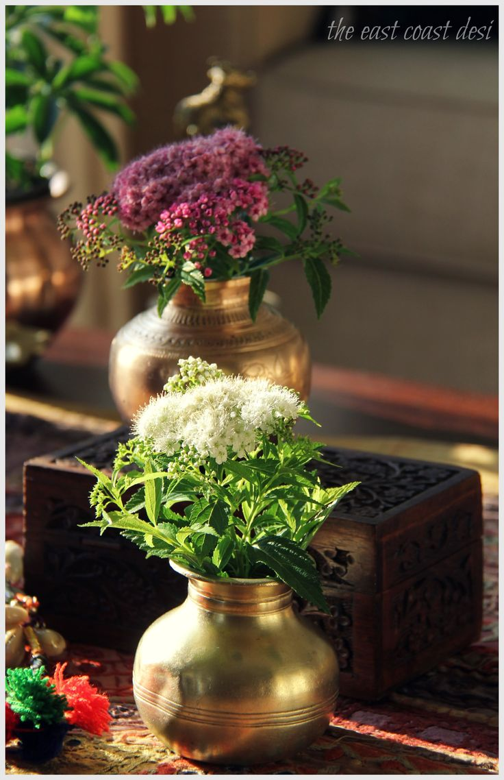 Display flowers in groupings of mini brass containers for an eclectic impact. (Image: Sruthi SIngh)