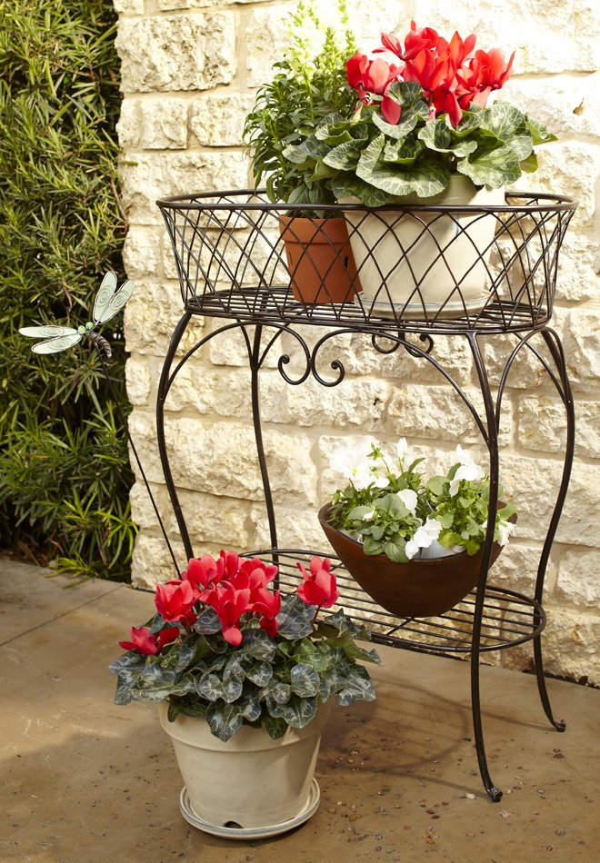 Give your flowers a lift with a Pier 1 Plant Stand - Beautiful! Is it bad that I'd paint it? White or a stunning color. #Pier1OutdoorParty #Sponsored #MC