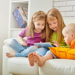 happy children holding digital tablet