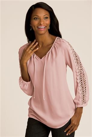 Long Sleeve Tie Front Blouse: Define feminine style in this flowing blouse with intricate open lace sleeve detail! Split neckline has a tie and subtle shirring. Button close detail at the sleeve.
