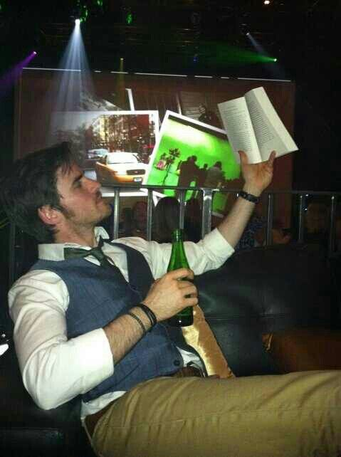 Then here he is reading...in a suit...with a beer. This picture has completed my night