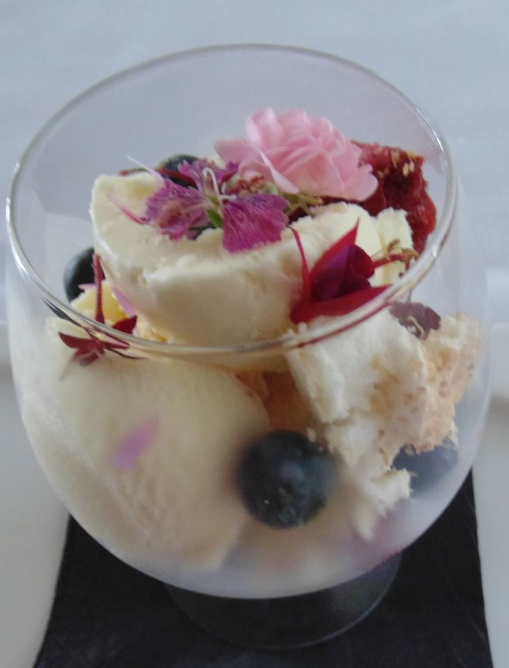 Vanilla bean icecream with edible flowers