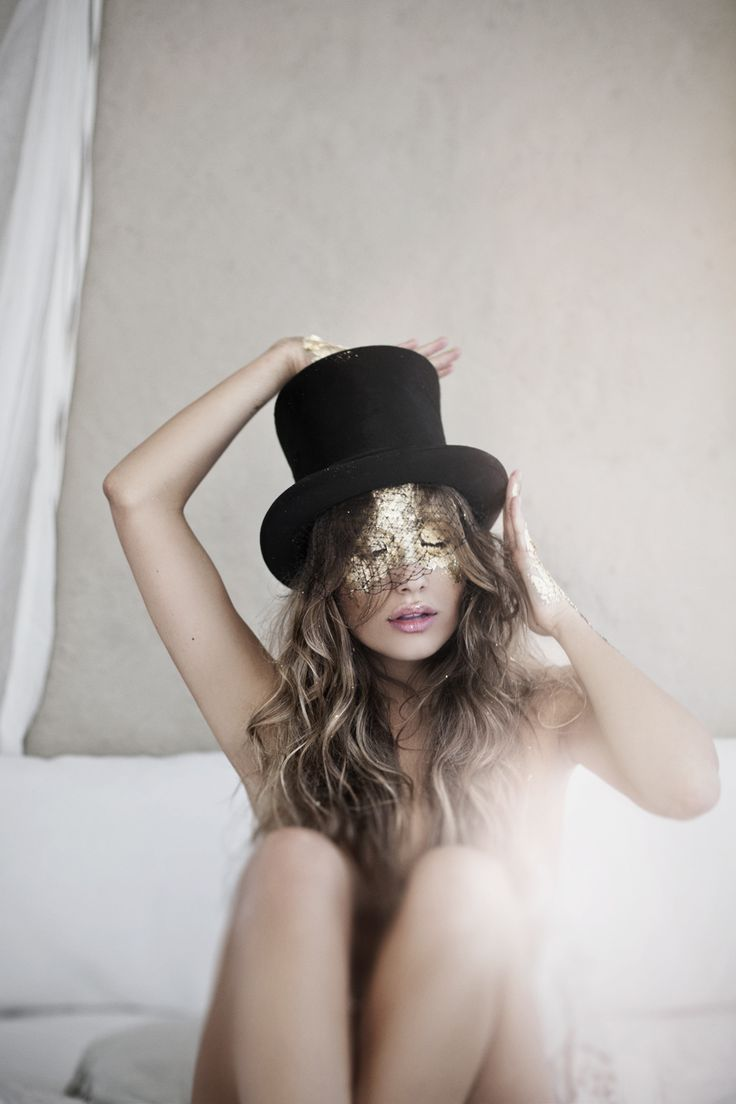 gold mask and top hat