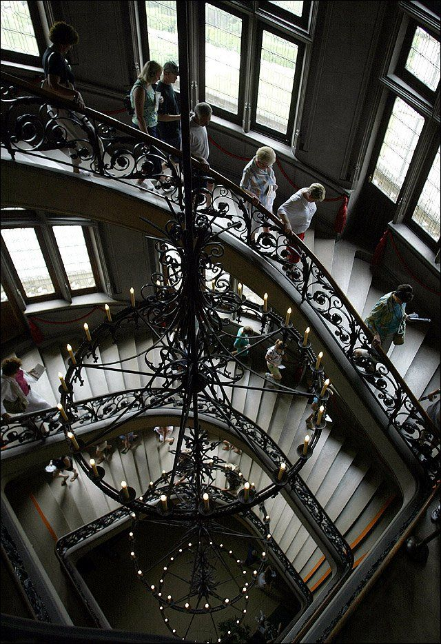 Visitors descend a grand staircase at the Biltmore House, Asheville, NC via LJWorld.com